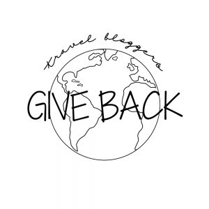 travel blogger give back